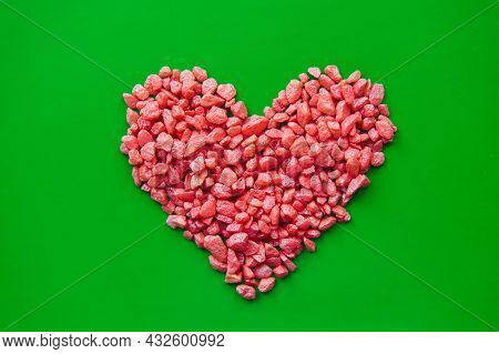 Pebble Stone Red Heart Laid Out With Small Decorative Stones On Green Background. Concept Of Love, R