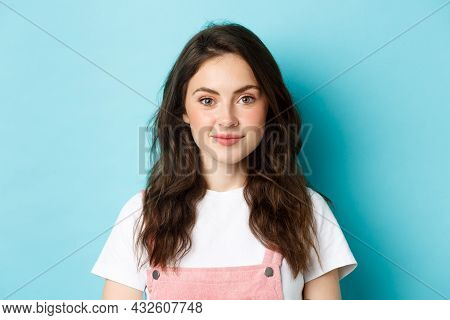 Close Up Of Beautiful Young Woman With Glamour Make Up And Curly Hairstyle, Smiling Cute And Staring