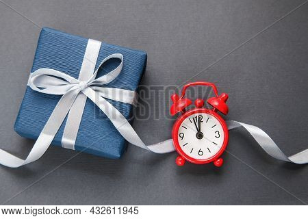 Alarm Clock, Dark Blue Gift Box On Grey Background. Gift Of Time. Gift For Men. Fathers Day. Present