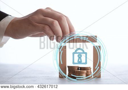 Female Hand Builds A Wooden House For Coins, Safety Of Money, Reliable Logins And Passwords, Protect
