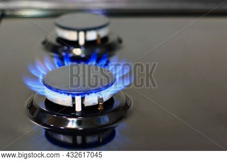 Blue Flames Of Gas Burning From A Kitchen Gas Stove. Gas Cooker With Burning Flames Of Propane Gas.