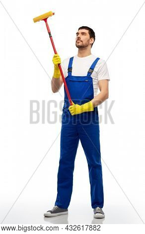 profession, service and people - male worker or cleaner in overal and gloves with window cleaning mop over white background