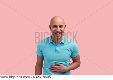 Cheerful Bald Homosexual Man With Bristle Laughs Out Loud, Touches Stomach With Hand, Closes Eyes, S