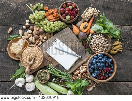 Blank Notepad For Copy Space And  Food Ingredients On Wooden Table. Shopping Food Supermarket And Cl