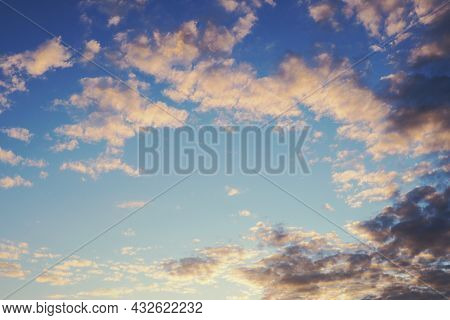 Blue Sky, Light And Dark Clouds At Sunset. Cloudscape Background Or Backdrop. Natural Wallpaper. End