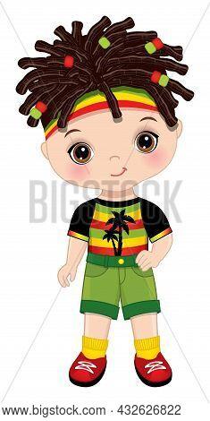 Cute Little Boy Wearing Rastafarian Outfit. Little Dark-haired Boy With Hazel Eyes And Dreadlocks. C