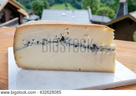 Cheese Collection, French Cheese Made From Raw Cow Milk Morbier And French Mountains Village In Haut