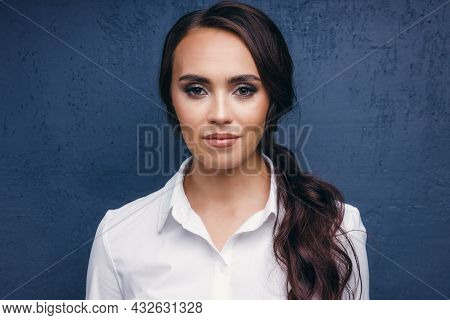 Portrait Of A Beautiful Middle-aged European Woman In A White Classic Blouse. Seductive Brunette Wit