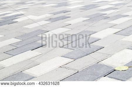 Concrete Or Paved Newly Laid Gray Paving Slabs Or Stones For Floors Or Walkways. Concrete Paving Sla
