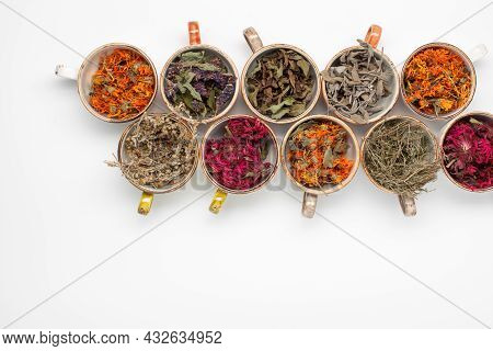 Assortment Of Dried Relaxing Tea Herbs In Colourful Cups On White Background Close Up. Calendula, Mi