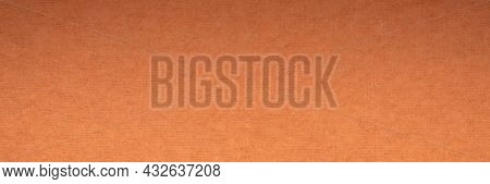 background and texture of orange handmade Indian rag paper created from recycled cotton fabric, panoramic banner