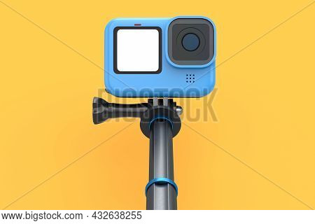 Photo And Video Lightweight Blue Action Camera With Selfie Stick On Orange