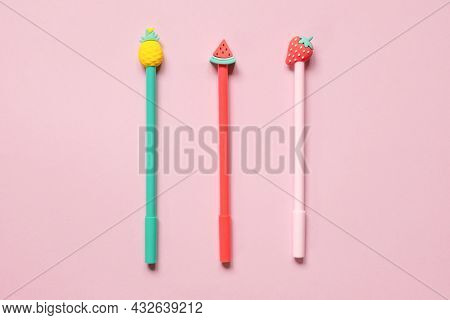 Multicolored School Pens On Pink Background. Funny Colorful Back To School Concept - Office And Stud