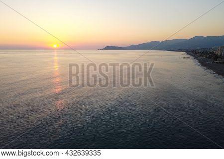 Aerial View Of Sun Setting Behind Mediterranean Sea Horizon. Beautiful Seaside Sunset. Mahmutlar, An