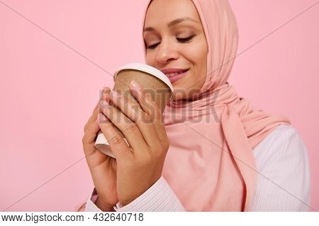 Arabic Muslim Pretty Woman With Covered Head In Hijab Drinking Hot Drink, Tea Or Coffee From Disposa