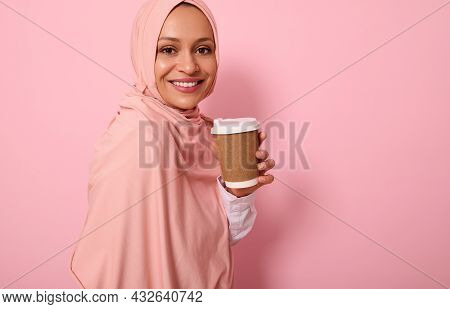 Close-up. Muslim Arabic Woman With Covered Head In Hijab Holds Disposable Cardboard Takeaway Cup, Sm