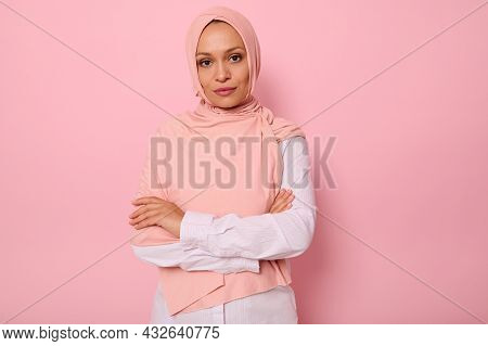 Waist-length Portrait Of Beautiful Arabic Muslim Woman In Pink Hijab Posing Looking To Camera With A