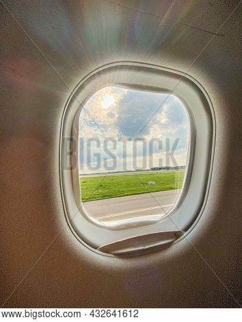 Warsaw Chopin Airport Airfield seen through an airplane window before takeoff or after landing