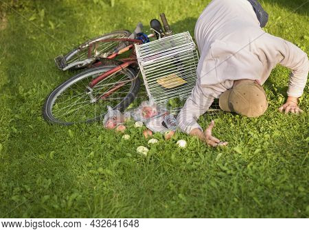 A Man Fell Off A Bicycle With A Shopping Basket, Outdoor Shot