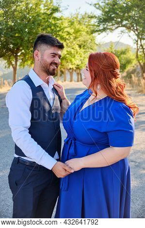 Caucasian Plus Size Red Headed Woman And Her Turkish Beloved Man Look To Each Other. Mixed Race Coup