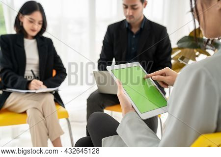 Businesswoman In Business Meeting Using Computer Proficiently At Office Room . Corporate Business Te