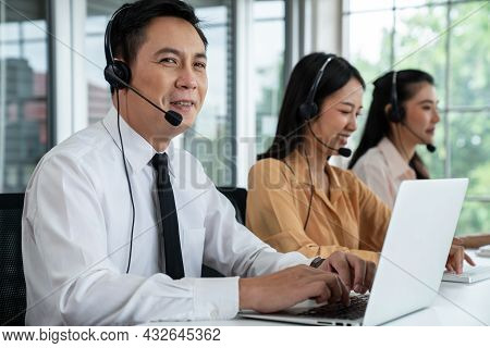 Business People Wearing Headset Working Actively In Office . Call Center, Telemarketing, Customer Su