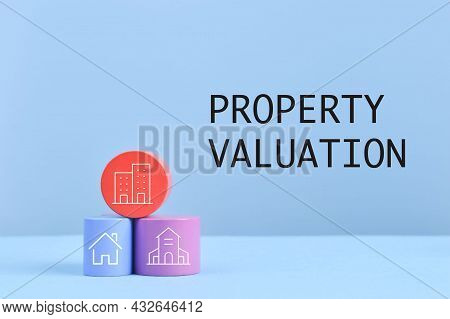 Wooden Blocks With Real Estate Symbols And Text Property Valuation
