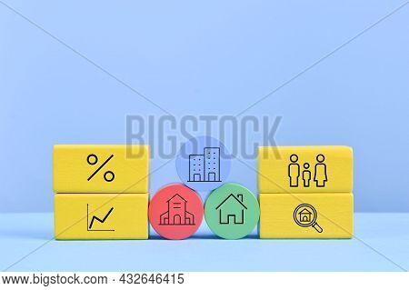 Wooden Blocks With Real Estate Symbols. Property Valuation Concept