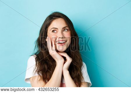 Close Up Of Coquettish And Glamour Woman Looking At Upper Left Corner Dreamy, Smiling Thoughtful, To