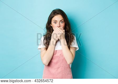 Portrait Of Shocked Glamour Girl Gasping, Covering Mouth With Hands And Staring At Camera Surprised,