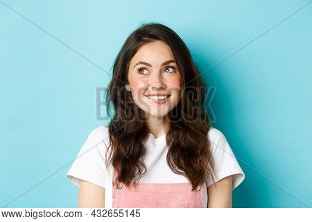 Close Up Of Dreamy Silly Girl Thinking Of Something, Looking At Upper Left Corner And Smiling Happy,