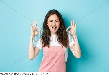 Very Well, Alright. Excited Smiling Brunette Guy Say Yes, Showing Okay Signs And Agree With You, Pra