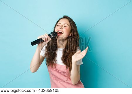 Carefree Beautiful Woman Perform Song, Singing In Microphone With Passion, Playing Karaoke, Standing