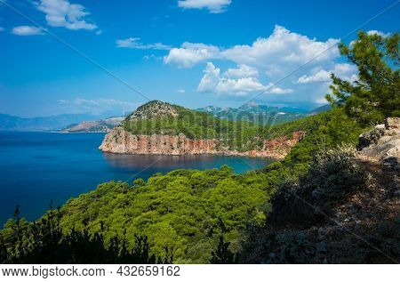Mediterranean coast of Turkey, Peninsula with coastal cliff, deep blue sea water, lush green forest, sunny day, Picturesque nature of Antalya province