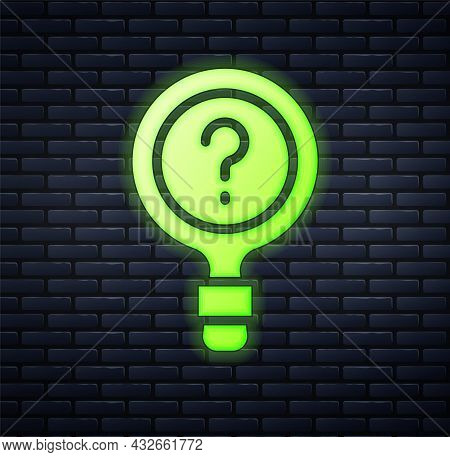 Glowing Neon Unknown Search Icon Isolated On Brick Wall Background. Magnifying Glass And Question Ma