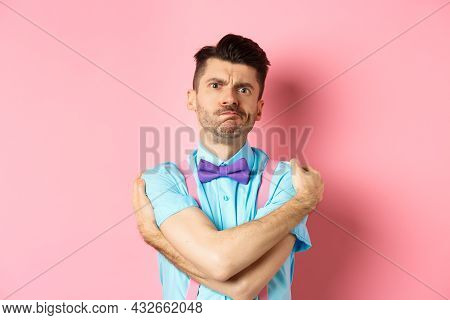 Timid Guy Embracing Own Body, Comforting Himself And Looking Offended, Sulking At You, Standing Insu