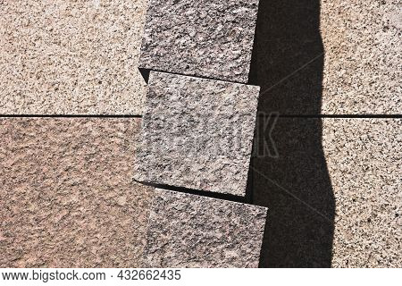 Granite Brown Paving Stones For The Sidewalk Are Laid Out With A Beautiful Abstract Pattern And Cast