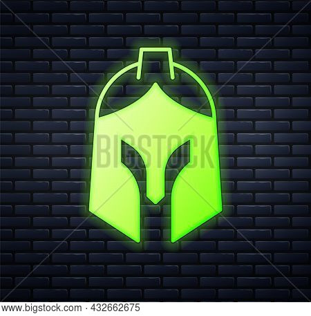 Glowing Neon Roman Army Helmet Icon Isolated On Brick Wall Background. Vector