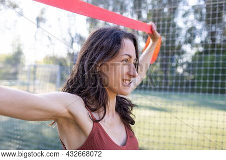 Beautiful Girl Goes In For Sports On The Street. Exercises With A Gymnastic Ribbon. Beautiful Body A