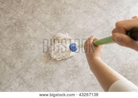 young woman scrubbing floor