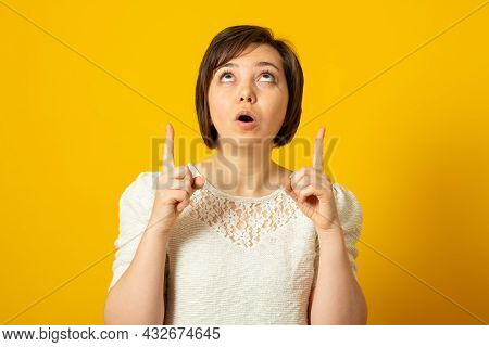 Fascinated Surprised European Woman Points Above Impressed By Awesome Promo Keeps Mouth Opened Dress