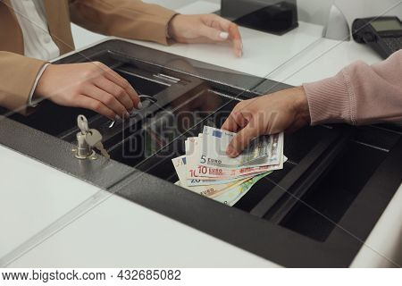 Man Giving Money To Cashier In Bank, Closeup. Currency Exchange