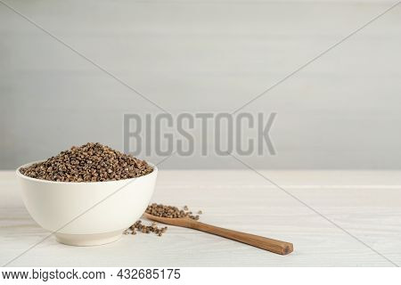 Ceramic Bowl With Chia Seeds On White Wooden Table, Space For Text. Cooking Utensils