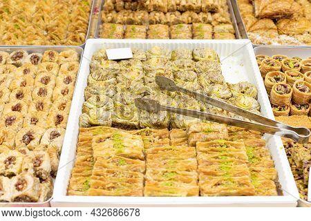 Traditional Turkish, Arabic Dessert Baklava. Different Types Of Baklava In Trays On Oriental Street