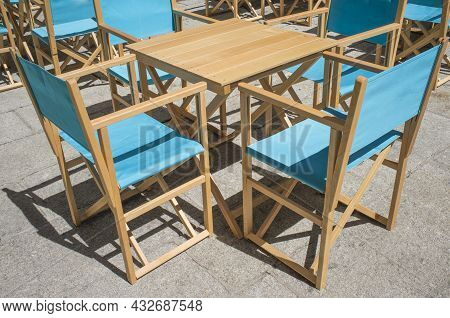 Downtown Restaurant Terrace With Folding Canvas Chairs. Terrace Restaurant Furniture Concept