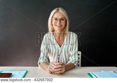 Webcam View Of Smiling Tutor Teacher Having Online Virtual Webinar Maths Class With Schoolchildren S