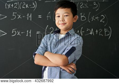 Happy Cheerful Proud Confident Smiling Cute Asian Schoolboy With Arms Crossed Standing Posing In Cla