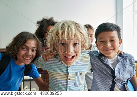 Portrait Of Cheerful Smiling Boy With Diverse Friends Schoolmates Schoolkids Having Fun Standing Pos