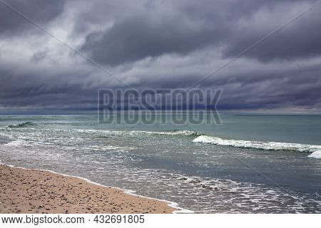 Dramatic Clouds Over The Baltic Sea Just Before A Sea Storm In Ventspils, Latvia