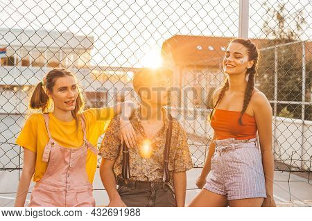 Group Of Teen Friends Hanging Out Together. Boy Between Two Girls